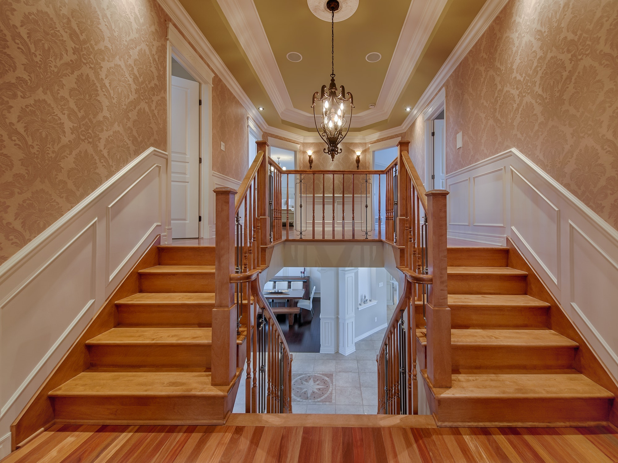 Double wooden staircases in luxury house
